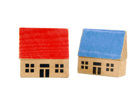 two miniature wooden houses
