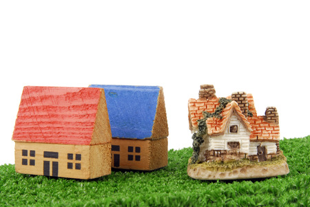 concept of miniature houses on grass