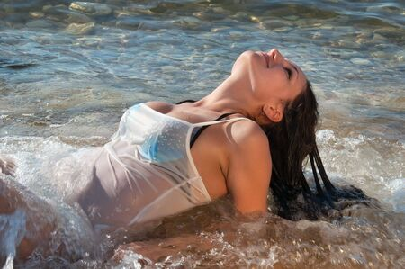 beach breast: beautiful girl in the sea in the waves Stock Photo