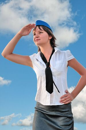 attractive woman stewardess looks into the distance photo