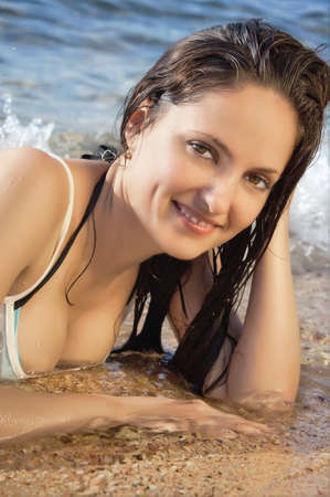 young beautiful girl on the beach in a bikini, portrait close up photo