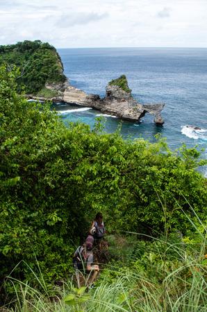 Descent to beautiful Atuh Beach, Nusa Penida (Bali, Indonesia). Stock Photo