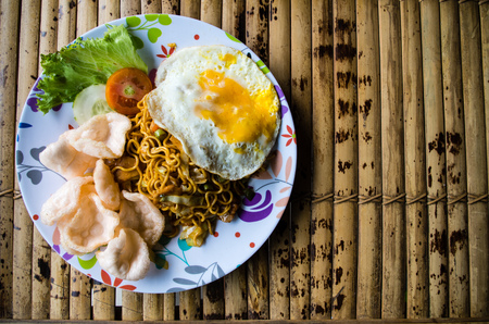 Typical Indonesian dish mie goreng copy space right.
