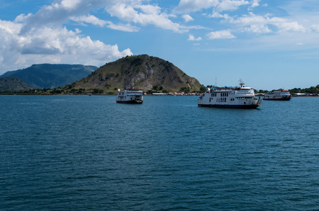 Three ferry boats waiting in front the harbour of Sumbawa island in Indonesia, March 2017. Editorial