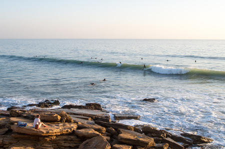 Surfer riding wave at panoramas in taghazout.