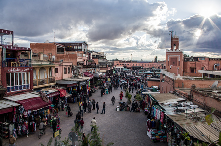 View over Marrakech Medina with tourists walking by local shops in January 2018, Morocco.