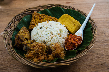Typical Indonesian dish Nasi liwet close-up.