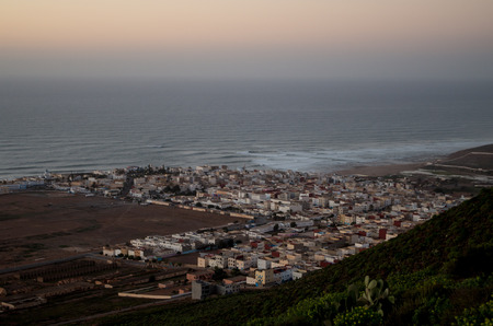 Town center of Sidi Ifni from top with ocean in the background.