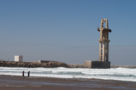 Surfers at the port of Sidi Ifni.