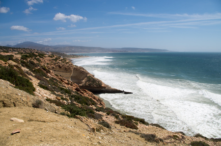 Waves arriving at Killer Point surf spot with view towards Taghazout.