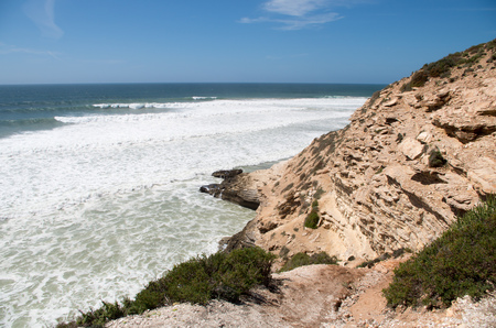 Waves rolling in at Killer Point surf spot near Taghazout.