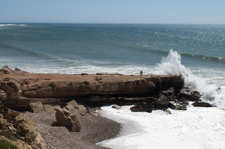 Water splashing at cliff near Taghazout, Morocco. Banque d'images