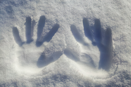 deep freeze: two hands print on snowflake