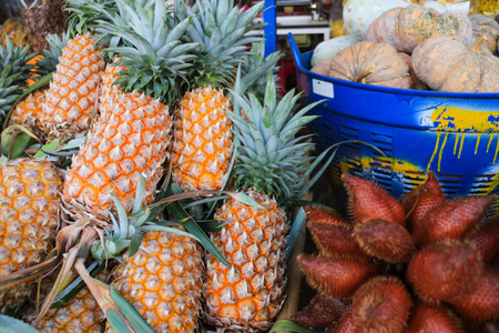 Thai fruits for sell in marketplace pineapple,zalacca,pumkin selective focus