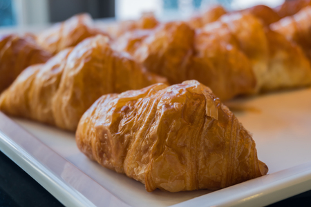 group of croissant close up on white salver selective focus 版權商用圖片