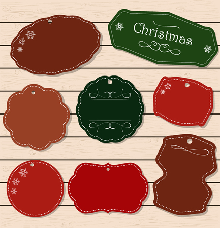 scrapbook background: Christmas holiday set - labels, tags and decorative graphic elements. Vintage collection for Xmas. Elements on a light wooden texture. Merry Christmas and Happy New Year.
