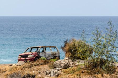militarily: Bunred down car on beach