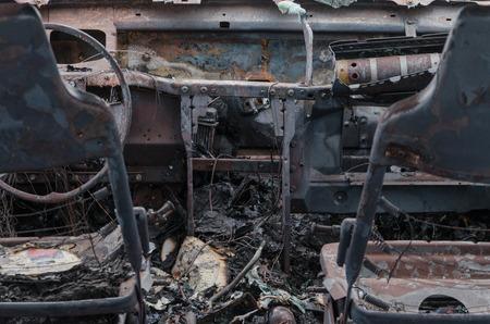 militarily: burned out car after crash