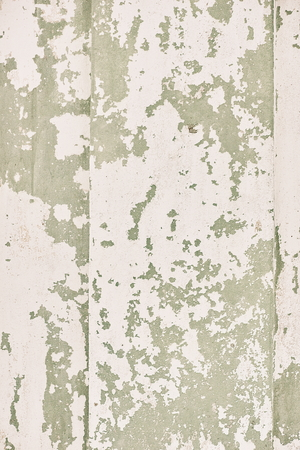 dirty wall of stucco somewhere fell off a pit of chipped fractures texture background