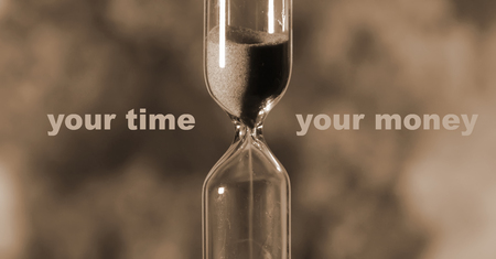 glass hourglass is pouring out the sand expires time. Your time your money
