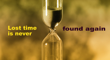 glass hourglass is pouring out the sand expires time. Lost time is never found again