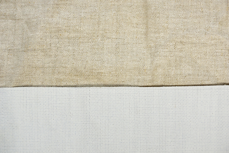a piece of white primed canvas and non-primed canvas