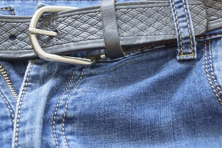 the belt on the jeans.denim texture. blue jeans Stock Photo