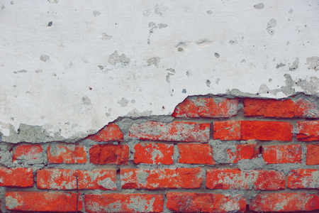 old red brick wall texture background. a piece of cement white plaster. copy space.