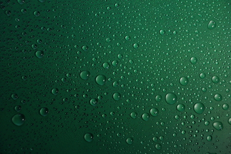 water drops on green background texture Stock Photo