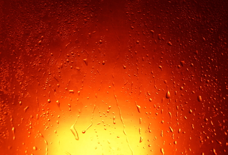water drops autumn red orange background close-up setting sun