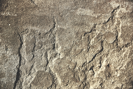 surface of an old wall with cement plaster grunge background texture close up