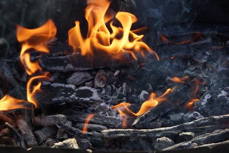 fire flame smoke embers to fry on the street close-up Фото со стока