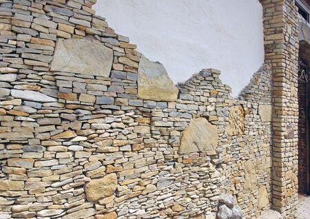 wall pieces natural rock stone limestone Sandstone texture background light. Rock texture. Exterior element.
