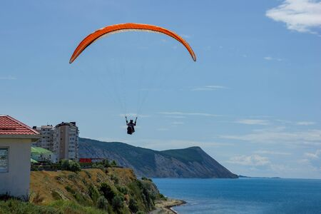 flying over the sea on a paraglider sports vacation in the resort of Anapa. Risk concept. Active lifestyle. Summer leisure. Stock fotó