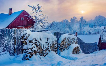 winter morning in the village. beautiful winter landscape snow house sunrise