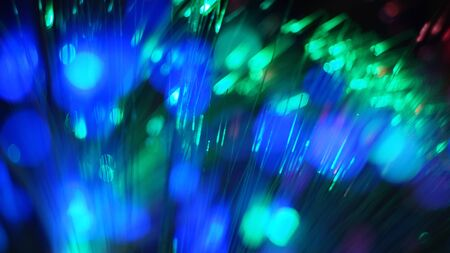 abstract festive background. blue green arrows flash lines circles blurred background bokeh. Magic Holiday decoration concept. Archivio Fotografico