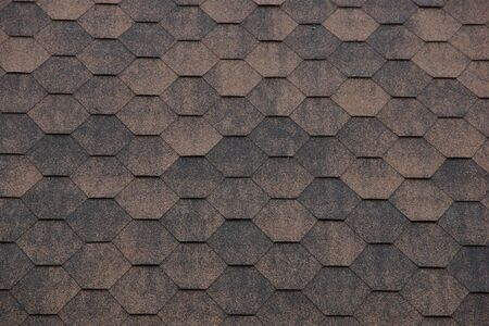 texture background bituminous shingles hexagonal honeycomb shape brown. roofing material for the roof of the house