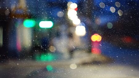 night winter city lights car lights people buildings blur Stock Photo