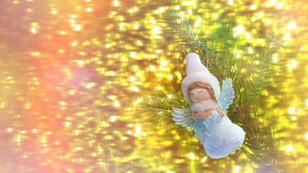 holiday background white angel Christmas on Golden bokeh background closeup