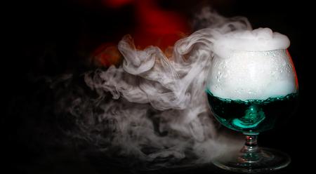 A glass of alcohol with smoke Archivio Fotografico