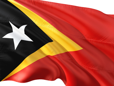 Flag of East Timor waving in the wind, isolated white background. Stock Photo