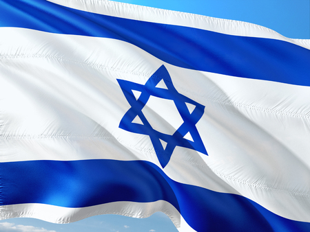 Flag of Israel waving in the wind against deep blue sky. High quality fabric. 写真素材