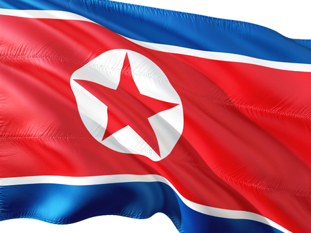 Flag of North Korea waving in the wind, isolated white background.