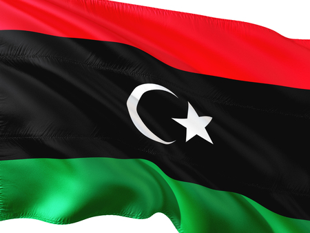 Flag of Libya waving in the wind, isolated white background.