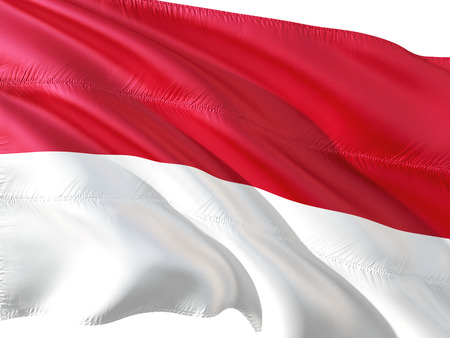 Flag of Monaco waving in the wind, isolated white background.