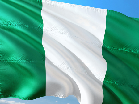 Flag of Nigeria waving in the wind against deep blue sky. High quality fabric. Stock Photo - 114290222