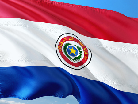 Flag of Paraguay waving in the wind against deep blue sky. High quality fabric. Standard-Bild