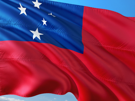 Flag of Samoa waving in the wind against deep blue sky. High quality fabric.