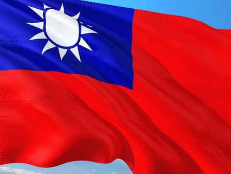 Flag of Taiwan waving in the wind against deep blue sky. High quality fabric.