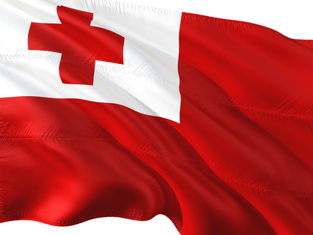 Flag of Tonga waving in the wind, isolated white background.